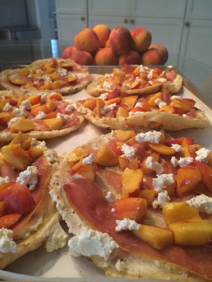 Its peach season!! Goats cheese, prosciutto and fresh pizzas on naan bread or pita bread..bake at 425 for 10 min fast easy and summerdelicious!!