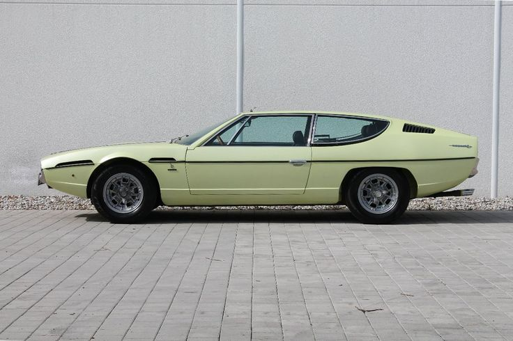 Lamborghini Espada. early 70's, had glass back panel for visibility....Like going fast? Call or click: 1-877-INFRACTION.com (877-463-7228) for local lawyers aggressively defending Traffic Tickets, DUIs and Suspended Licenses throughout Florida