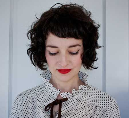 adorable curly bob with short bangs