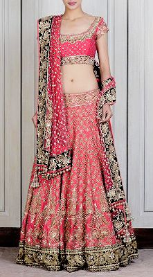This Pink raw silk lengha intricately hand-embroidered zardozi motifs all around. Densely embroidered contrasting black velvet border on the hemline. Accentuation's with perals, Swarovski's and kundan