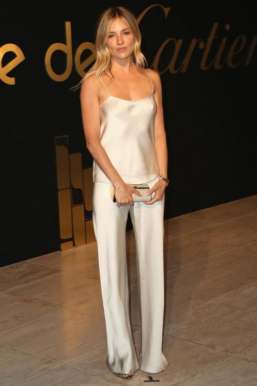 Sienna Miller wearing The Row Selip Silk Pants, The Row Biggins Cami and Tod's Double T Clutch