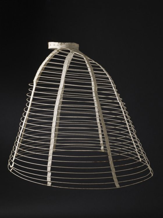 LACMA Womans Cage Crinoline England, circa 1865 Costumes; underwear (lower body) Cotton-braid-covered steel, cotton twill and plain-weave double-cloth tape, cane, and metal Center back length: 36 1/2 in. (92.71 cm); Diameter: 38 1/2 in. (97.79 cm)
