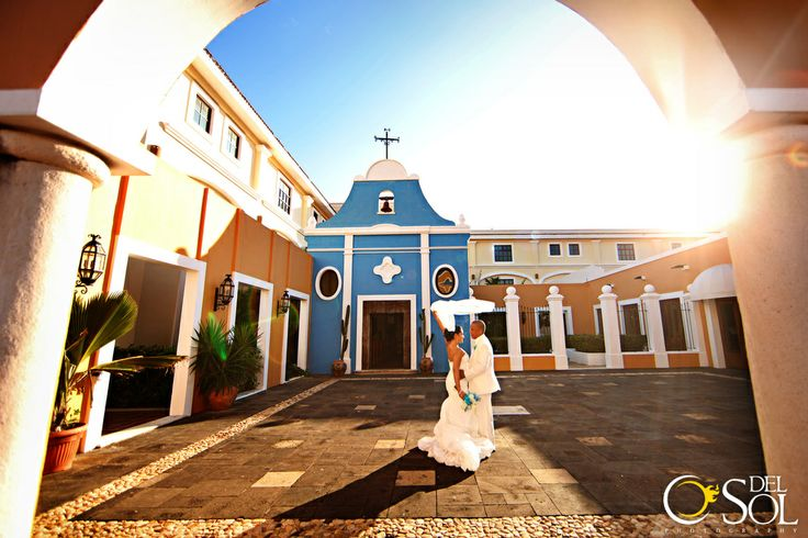 brride and groom destination wedding in front of the wedding chapel at Dreams Tulum Hotel, MX