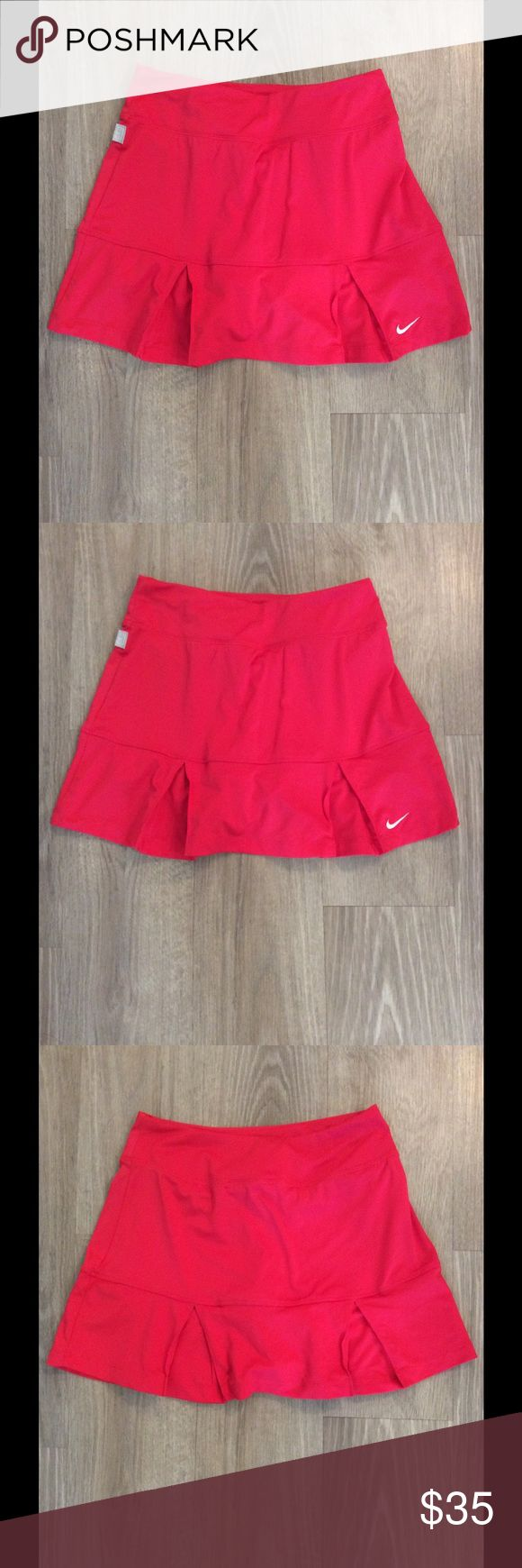 Women's Red Nike tennis skort Women's red pleated Nike Dri - Fit tennis skort. No flaws and no discoloration. Comfortable and has no piling. Nike Shorts Skorts