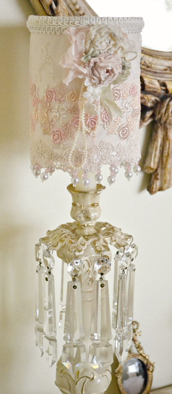 ON SALE!!! This listing is for one gorgeous handmade lace lampshade with vintage ribbon work flowers and loops of ivory bead trim. Lace is cream with muted dusty rose, mauve, and peach flowers. Has two layers of dangling pearls and crystal beads. Lampshade measures 5 1/4 tall (6 with beading) and 4 1/4 wide. Perfect condition! IF YOU WISH TO PURCHASE MULTIPLE VINTAGE ITEMS PLEASE CONTACT ME IN ADVANCE SO THAT I CAN ADJUST SHIPPING CHARGES. THANKYOU!    Please convo me with questions...
