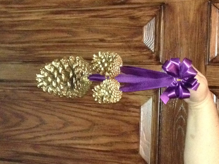 hanging gold pine cone pew decor aubergineplum ribbon ceremony decorations
