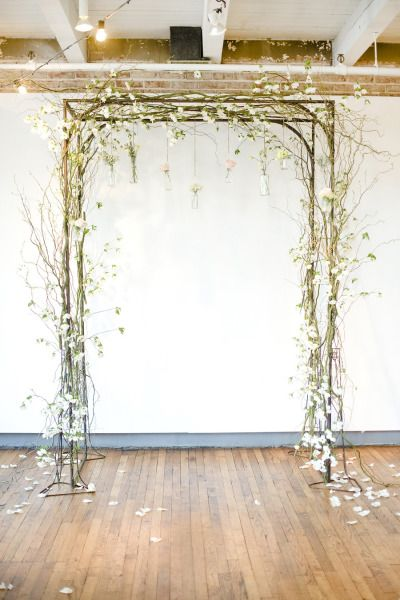 DIY chuppah with hanging vases: http://www.stylemepretty.com/2014/09/25/blush-pink-chic-downtown-memphis-wedding-at-409-south-main/ | Photography: Ashley Upchurch - http://ashleyupchurchphotography.com/