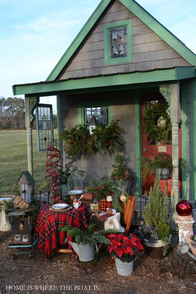 Potting Shed decorated with greenery, bird houses and tartan for Christmas! #christmas #pottingshed