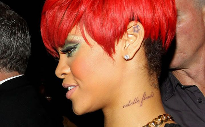 "[Riri's tattoo] ""rebelle fleur"" which means ""rebellious flower"" in french."