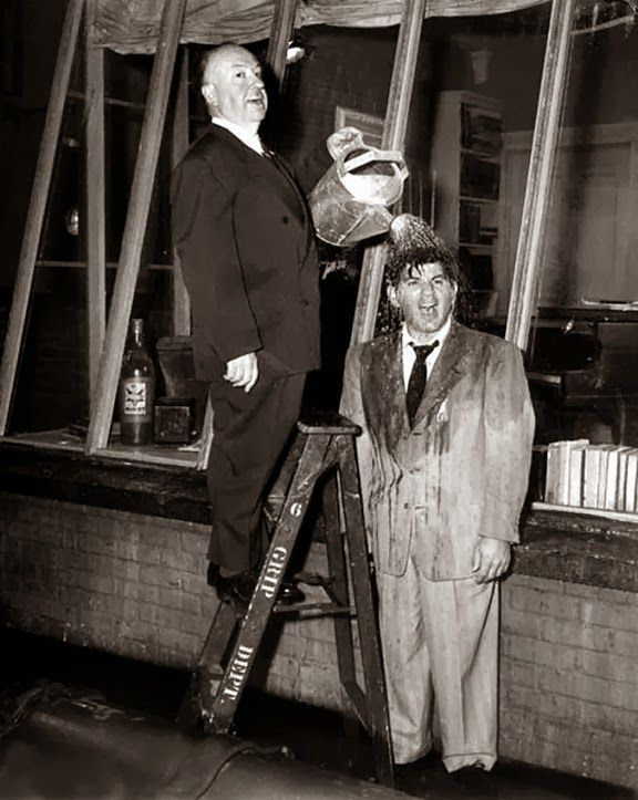 """Alfred Hitchcock and Ross Bagdasarian on the set of """"Rear Window"""", 1954"""