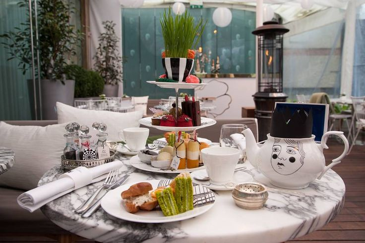 The playful table setting for the Mad Hatter-themed afternoon tea at the Sanderson Hotel.