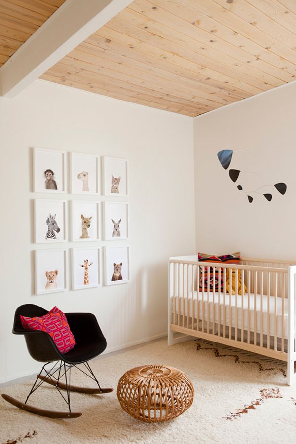 love the animal prints, peeking out of the frames. they are the perfect wall art in this clean, neutral nursery.