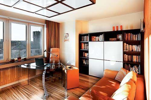 orange home office furniture and black bookshelves are modern interior decorating ideas