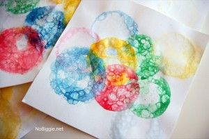 Your preschoolers will love to make rainbow bubble paper! Idea from BabyCenter Blog. #Bubbles #Rainbow #KidArt