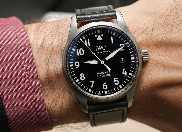 Hands-on review & original photos from SIHH 2016 of the IWC Pilot's Watch Mark XVIII watch with price, background, specs, & expert analysis.