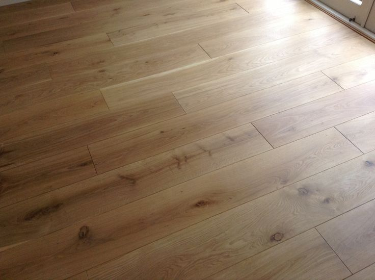 """engineered oak, w/ """"a thin coat of white tint 'Raw' Osmo hard wax oil, followed by a medium coat of clear matt Osmo hard wax oil with a light black bison polish to finish"""" (more photos)"""