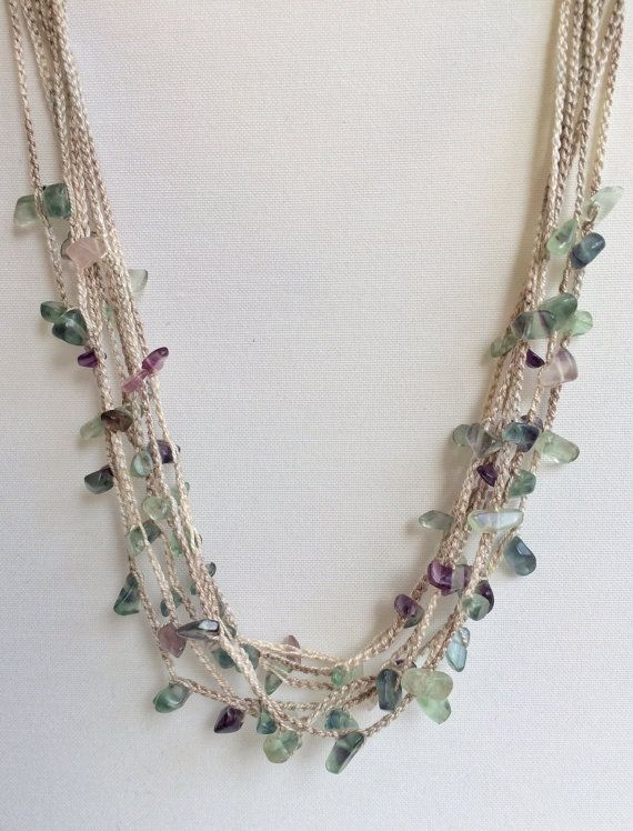 This elegant necklace was made with 8 strands of crochet chain, each one containing a mixture of gemstone beads between stitches. The result is luminous and beautiful. I used 100% cotton thread and glass beads. All my creations are one of a kind.