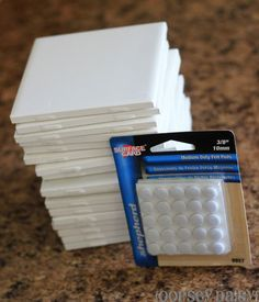 I started out with a trip to Home Depot. These 4x4 tiles were only 19 cents each! It doesn't get much cheaper than that! And I bought a package of 72 felt mounting circles for about Not too shabby!