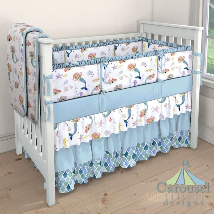 Crib bedding in Watercolor Mermaids, Solid Aqua, Blue Watercolor Scales. Created using the Nursery Designer® by Carousel Designs where you mix and match from hundreds of fabrics to create your own unique baby bedding. #carouseldesigns