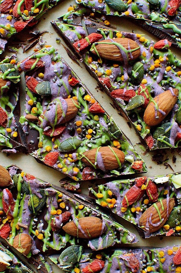 Superfood chocolate bark - dark chocolate topped with almonds, goji berries, seeds, bee pollen and white chocolate flavoured with matcha and freeze dried blueberry powder