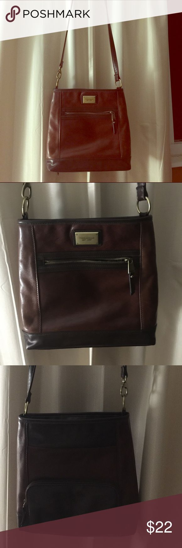 Tignanello leather purse in two tone brown Tignanello leather crossbody purse in two tone brown, a deep burgundy brown on the body and a darker brown on the trim and bottom of bag. Used a handful of times but in mint condition. No wallet required because back pocket is built in wallet with 8 places for your cards and a zippered area for money. 8 Length and 10 width. Tignanello Bags Crossbody Bags