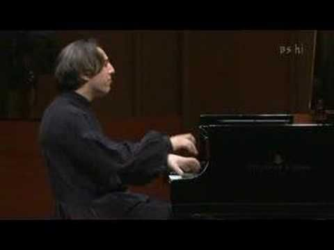 Fazil Say - Black Earth (Kara Toprak)         He not only plays the piano keys in this piece but also the piano strings.