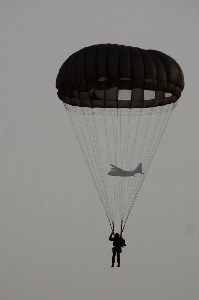 Paratrooper with mother ship in the background