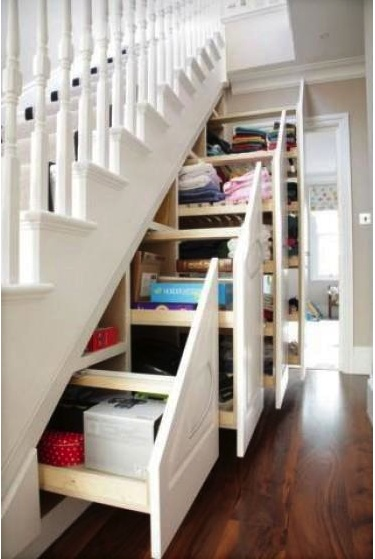 slide-out storage under stairs; basement?