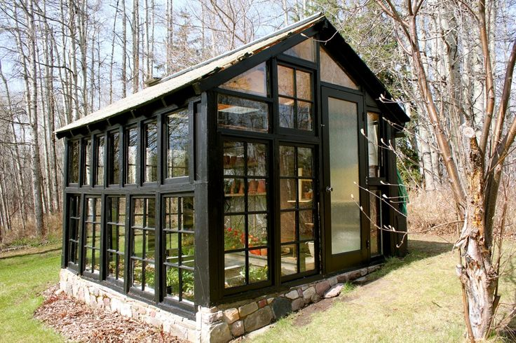 Greenhouse Made From Old Windows | greenhouse made from old windows | cabinorganic. Check out the stone foundation!