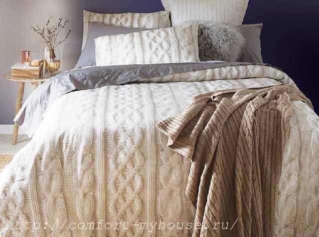 белое вязаное одеяло