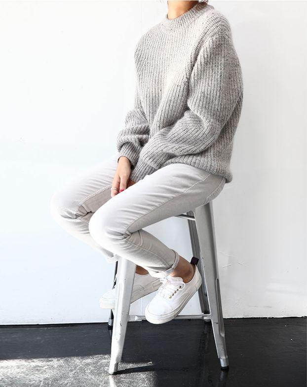 Knitted grey jumper mixed with tailored trouser and trainers.