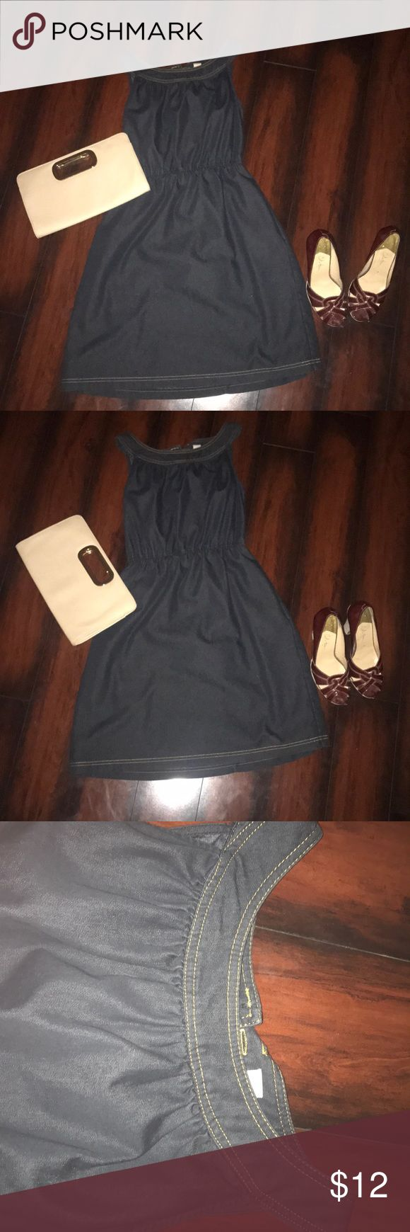 Denim Summer Dress Denim shirt summer dress. Gold buttons in the back. Pinches in the middle to show off the waste. Adorable for a date with some heels or pair it with some sandals for a more casual look. Dresses Mini