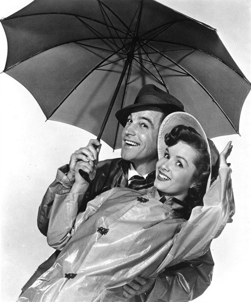 Singing in the Rain! Now why doesn't the whole of Britain look this    cheery?
