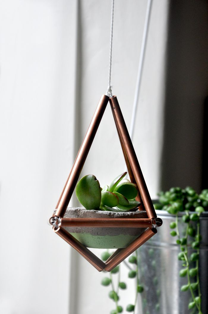 Diamond copper mobile by Twin Creative, with petite concrete planter and baby succulent plant <3