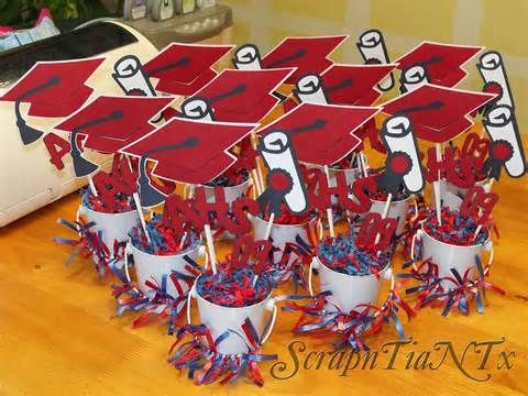 Cute center pieces...little craft buckets (miniature), simple strips of ribbon, styrofoam inside, and scrapbook cut letters and craft sticks.