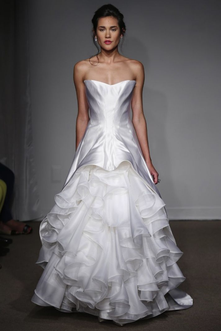 A unique take on the ruffled ballgown corset top wedding dress from Anne Maier.