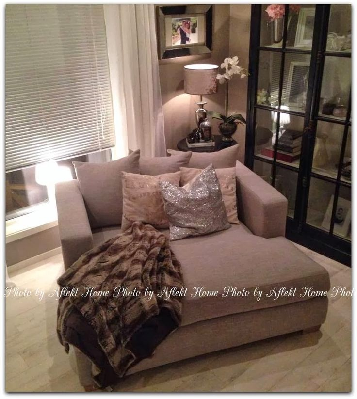 oversized chairs with extra pillows and a soft throw if looked at from a distance it could resemble a quail