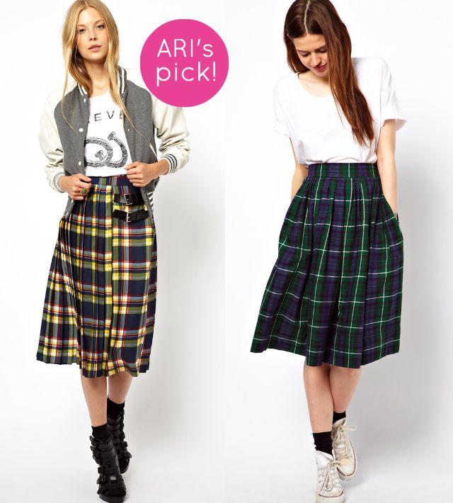 Falda midi plisada con estampado de cuadro escocés multicolor y doble hebilla a la cintura (60,65 euros) y de corte amplio a media pierna (48,52 euros), ambas de Asos.
