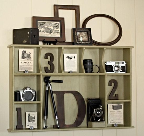 Made from one of those maple shelves or hutch top so many folks had in the 60s.Now a beautiful camera display. Garage sales here I come.