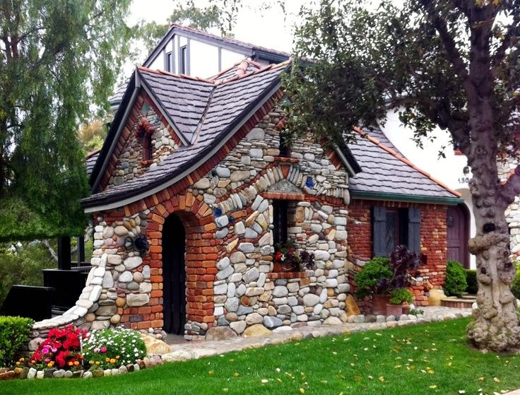 Lots of stone and charming roof lines... very cool cottage