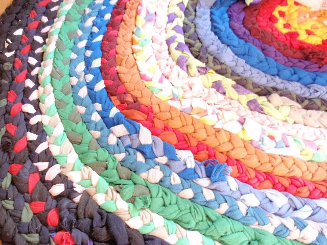 Don't throw away those old t-shirts! Use them to create a colorful braided rug, perfect for the kid's play room!