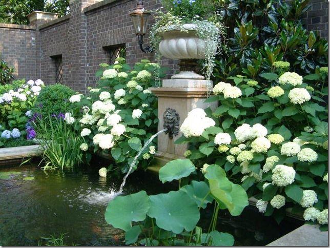 Fountain in walled courtyard garden, Atlanta