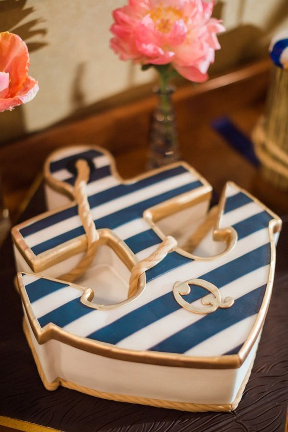 navy gold striped anchor wedding cake / http://www.himisspuff.com/navy-blue-and-gold-wedding-ideas/4/