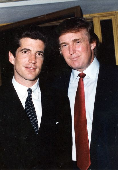 Portrait of American lawyer and publisher John F Kennedy Jr and businessman Donald Trump as they pose together at the MaraLago estate Palm Beach...