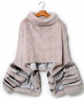MINK FUR PULLOVER PONCHO WITH DETACHABLE SILVER FOX FUR CUFF Mink fur pullover poncho with detachable Silver Fox fur cuff, made of premium Mink and Silver Fox fur. Stand collar style. Silver Fox fur cuffs conjoined with zippers and concealed press-studs. Fully lined with color toning satin finished lining. One poncho, two ways to wear.