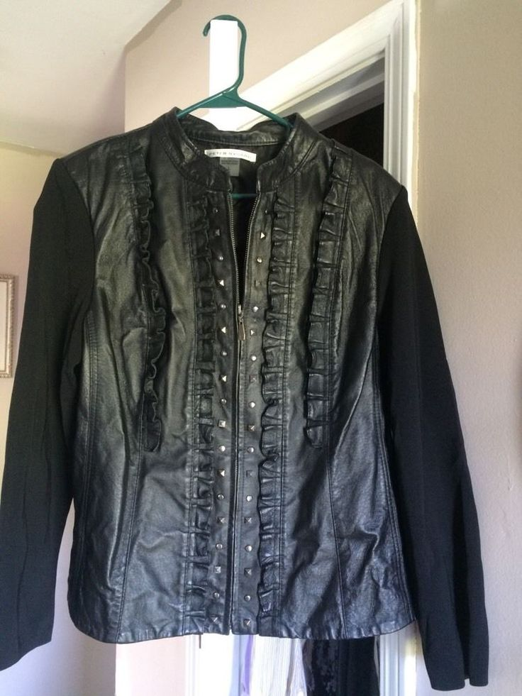 Very nice jacket great detail with leather and small studs has knit sleeves of rayon and nylon beautiful jacket bought and was too small.