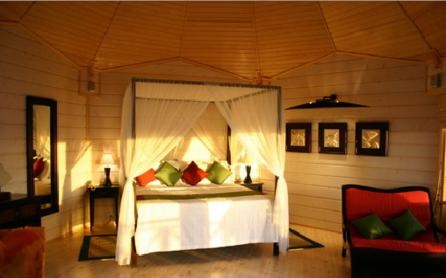 Water Villa bedroom at Komandoo Maldives; a popular honeymoon destination or the ideal place for those seeking luxury in a romantic hideaway.