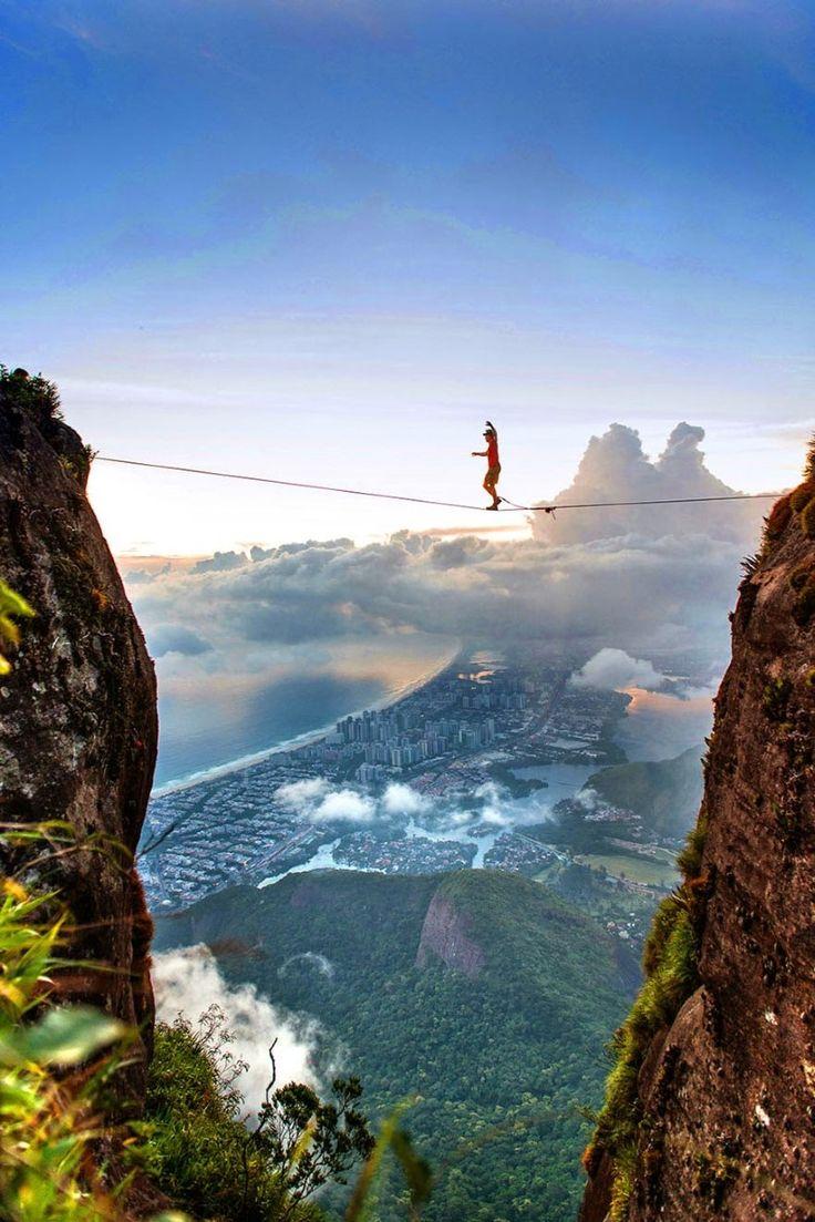 Brian Mosbaugh walks the Pedra de Gavea highline, high over the city of Rio de Janeiro, Brazil.