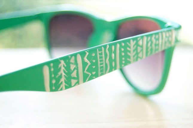 18 Unusual Ways to Style Up Your Sunnies via Brit + Co. // We love the white tribal inspired pattern on these, and think a fine point paint pen would make for even cleaner lines.