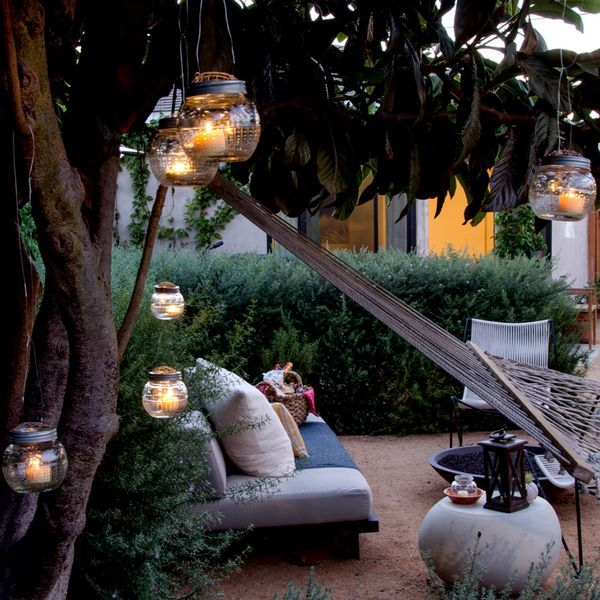 Hanging lanterns add more than subtle lighting and a romantic feel. Put them up at your next outdoor party! #DIY #outdoors #lighting